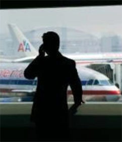 Man on cell phone at airport
