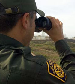Border Patrol agent with binoculars