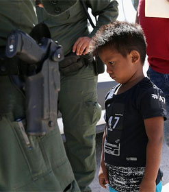 Little boy surrounded by border patrol