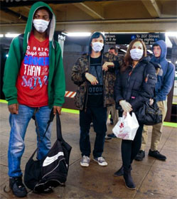Masked New Yorkers at subway