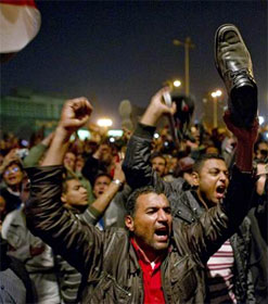 Egyptian protester waving shoe