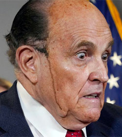 Rudy Giuliani with black hair dye streaming down his cheek