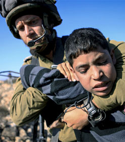 Israeli soldier and Palestinian child