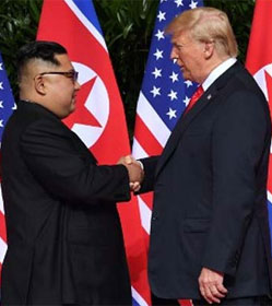 Kim Jong Un shaking hands with Donald Trump