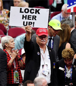 "Trump supporter holding ""Lock Her Up"" sign"