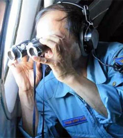 Malaysia Flight 370 searcher with binoculars