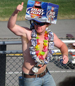 Man wearing Bud Lite carton as hat and empty beer cans as necklace