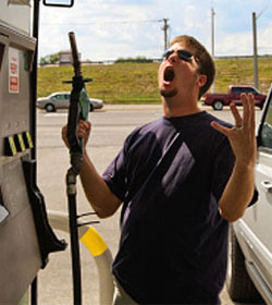 Frustrated man at gas pump