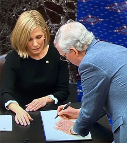 "Mitch McConnell signs oath book after swearing to do ""impartial justice"" at Senate Trump impeachment trial"