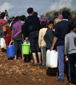 Syrian refugees in line for water