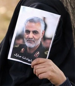 Iranian mourner holding photo of Gen. Soleimani
