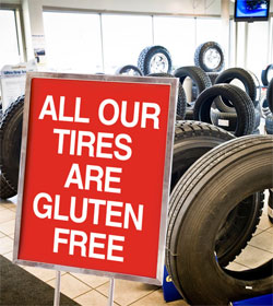 """All our tires are gluten free"" sign at Fountain Tire"