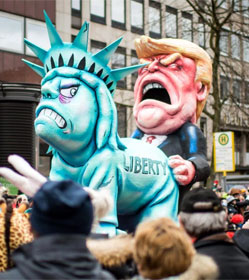 European parade float showing Trump humping the Statue of Liberty