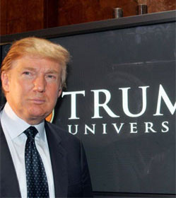 Donald Trump in front of Trump University sign