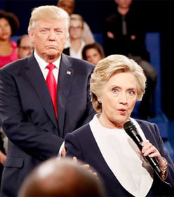 Donald Trump standing behind Hillary Clinton at second presidential debate