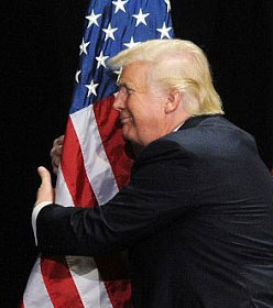 Donald Trump hugging American flag