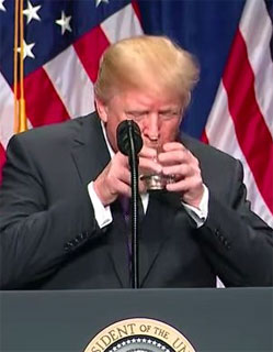 Donald Trump drinking water with two hands