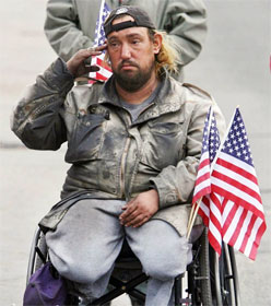 Veteran in wheelchair saluting flag