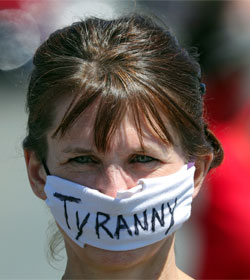 "Woman wearing mask that says ""Tyranny"""