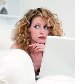 Worried gal at laptop